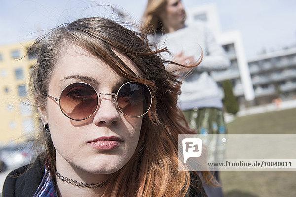 Portrait of a young woman wearing sunglasses  Munich  Bavaria  Germany