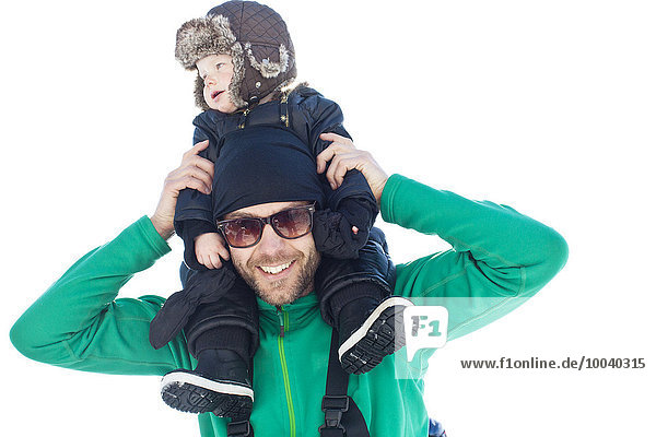 Father with baby son on shoulders