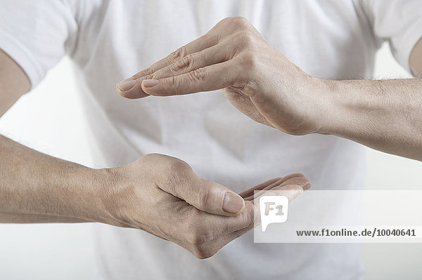 Man's hands with protective gesture  Bavaria  Germany Man's hands with protective gesture, Bavaria, Germany