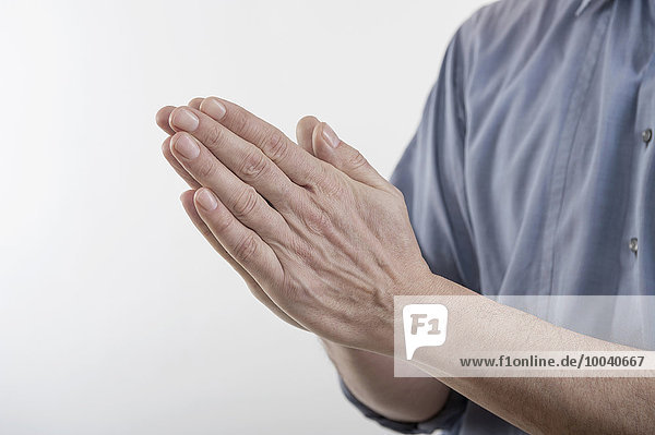 Man's clasped hands in prayer position  Bavaria  Germany Man's clasped hands in prayer position, Bavaria, Germany