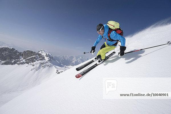 Young man skiing  Rofan  Tyrol  Austria