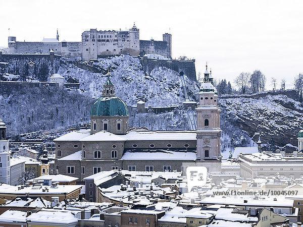 Austria  Salzburg State  Salzburg  Old town  View to Salzburg Cathedral and Hohensalzburg Castle in winter