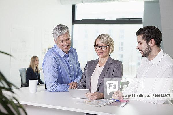 Businesspeople talking in meeting