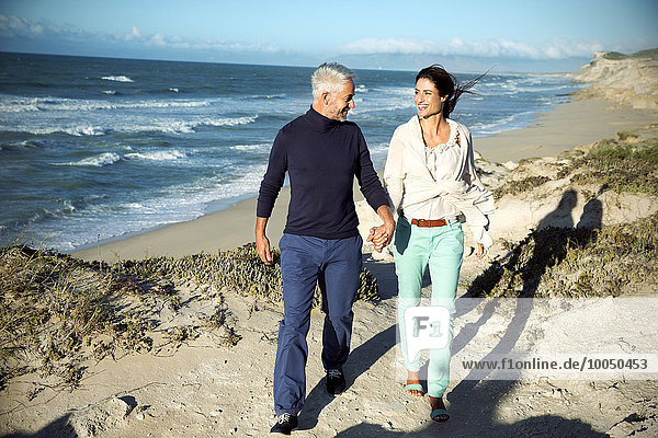 South Africa  couple walking along the coast hand in hand