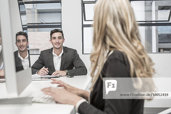 Businessman and businesswoman working in meeting room