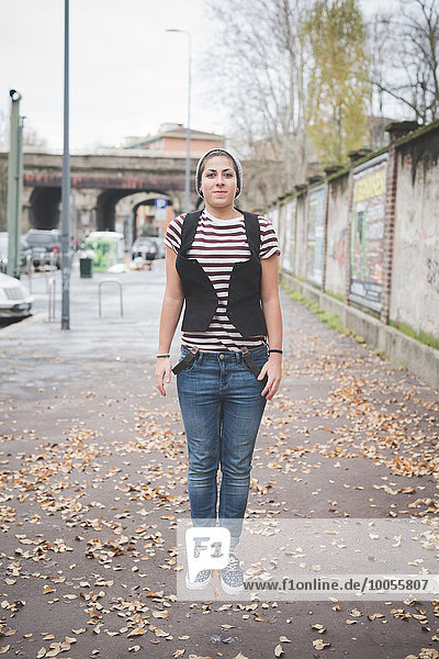 Teenager jumping on street