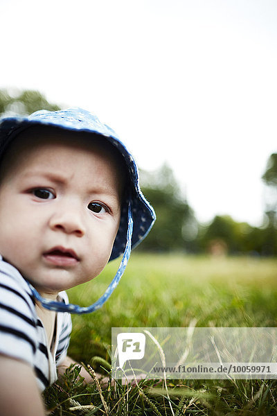 Close up portrait of baby boy looking at camera
