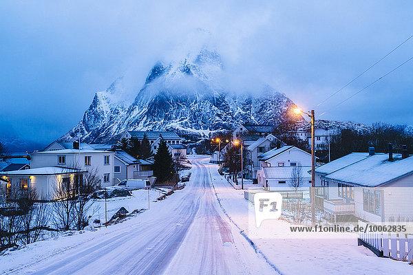 Snow covered road through at dusk  Reine  Lofoten  Norway