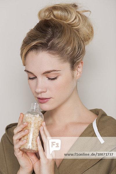 Beautiful woman smelling bath salt