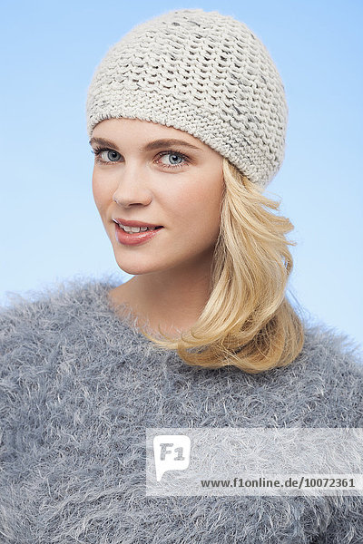 Portrait of a beautiful woman in knitted hat