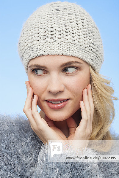 Beautiful woman in knitted hat