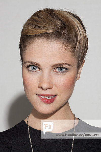 Portrait of a beautiful woman biting lip