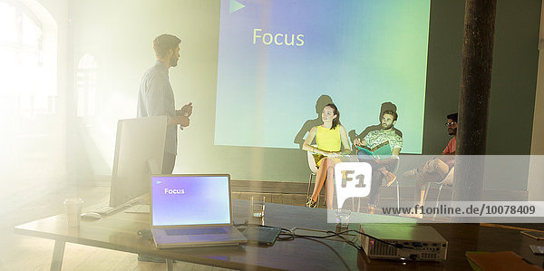 Business people preparing audio visual presentation on Focus