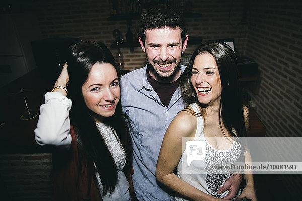 Caucasian friends laughing in nightclub