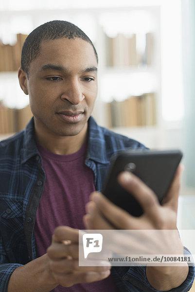Black man using digital tablet
