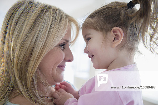Close up of Caucasian mother holding daughter