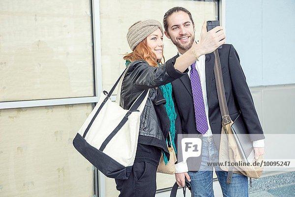 Geschäftsleute  die Selfie nehmen