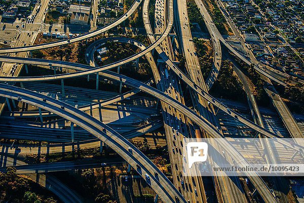 Aerial view of curved flyovers and multi lane highways  Los Angeles  California  USA