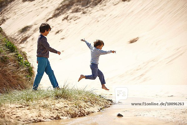 Two young boys playing on beach
