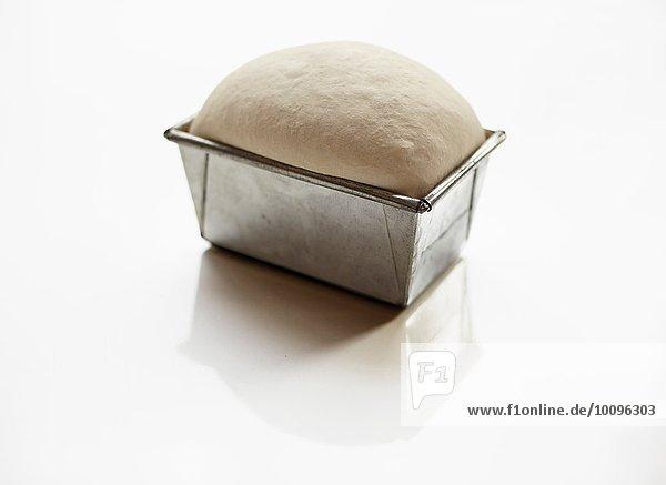 Bread dough prepared in loaf tin