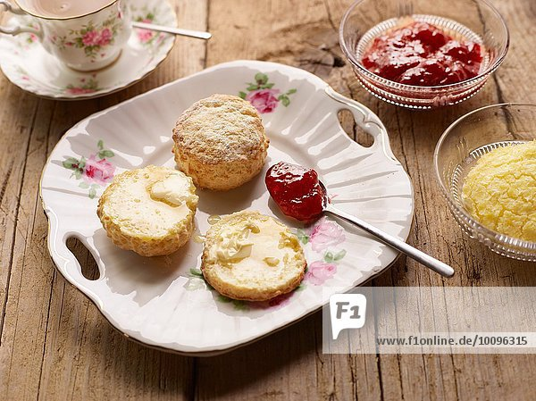 Afternoon tea of with fresh baked scones with jam and clotted cream