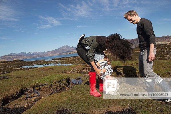 Mother tickling son  Loch Eishort  Isle of Skye  Hebrides  Scotland