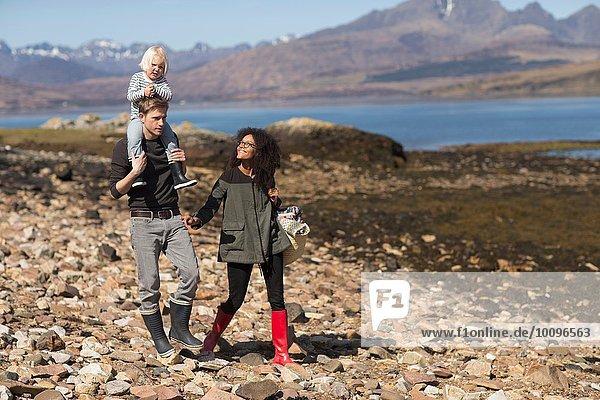Family on walk  man carrying son on shoulders  Loch Eishort  Isle of Skye  Hebrides  Scotland