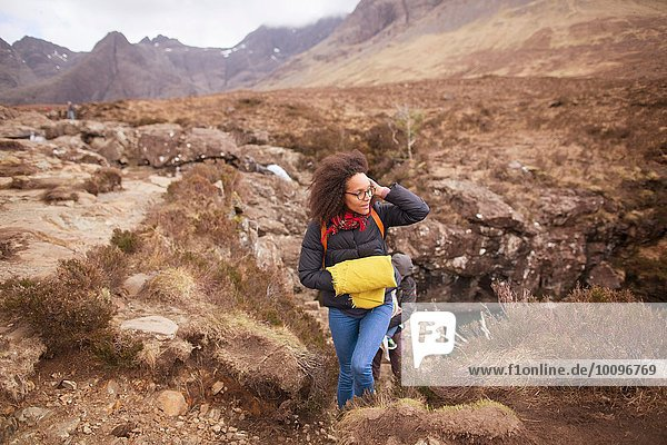 Mid adult woman hiking  Fairy Pools  Isle of Skye  Hebrides  Schottland