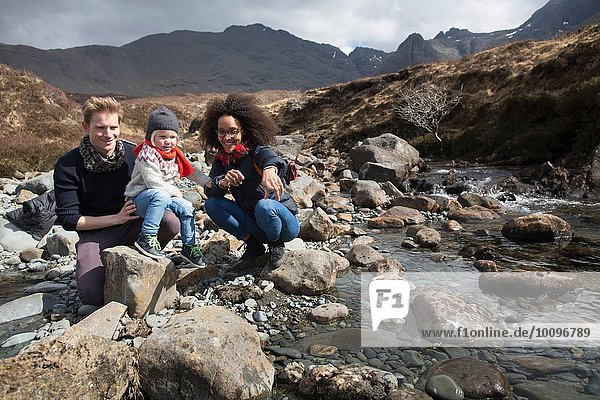 Family by stream  Fairy Pools  Isle of Skye  Hebrides  Scotland
