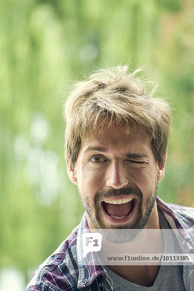 Man winking playfully  portrait