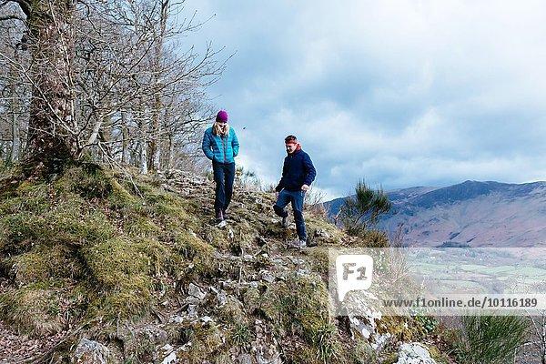 Young couple hiking  Derwent Water  Keswick  Lake District  Cumbria  United Kingdom