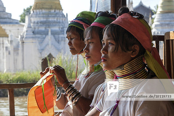 Women from the Padaung tribe in typical dress and headgear  necklaces  Inle Lake  Shan State  Myanmar  Asia