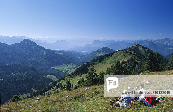 Hikers taking a rest  Mt. Hochries  Chiemgau  Bavaria  Germany  Europe