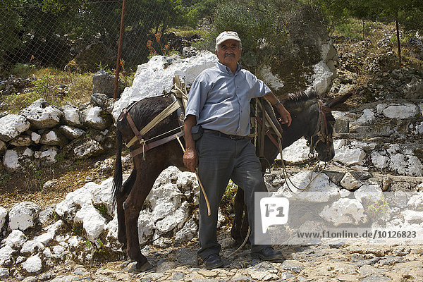 Man with a donkey at the birth cave of Zeus in Psichro  Lassithi Plateau  Crete  Greece  Europe