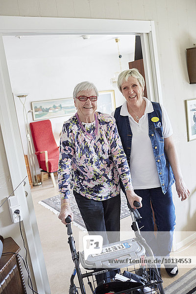 Nurse in care home with senior woman