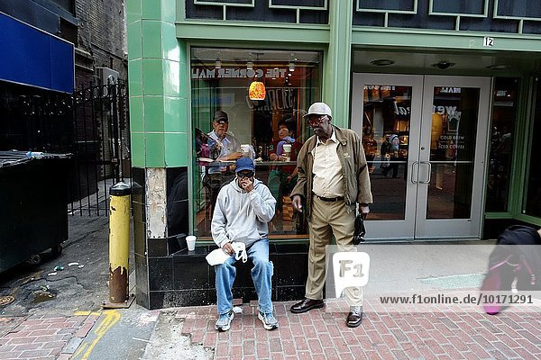 Two black men in front of coffee shop. Downtown crossing. Boston  Massachusetts  USA