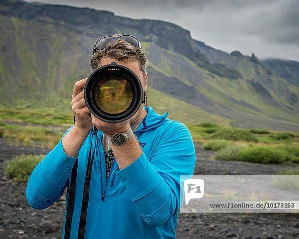 lang langes langer lange Wasserfall Fotograf Blendenfleck lens flare schießen Seljalandsfoss Island