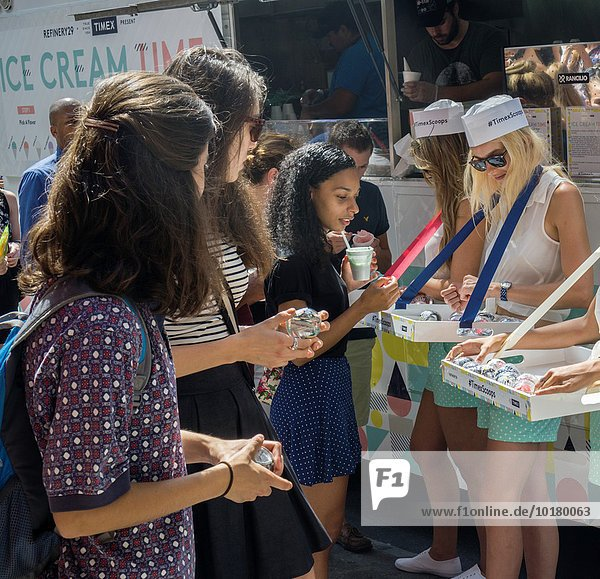 Hundreds line up near Union Square in New York for free ice cream and a free Timex watch courtesy of the fashion website Refinery29 and Timex watches. Refinery29 is a fashion and style websit