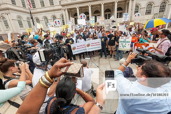 Taxi drivers and supporters rally on the steps of New York City Hall for a cap on For-Hire-Vehicles FHV allowed on the city´s streets  specifically e-hail services like Uber and Lyft. The New York City Council is scheduled to vote on the cap and both Uber and the Taxi Industry are lobbying the councilmembers.