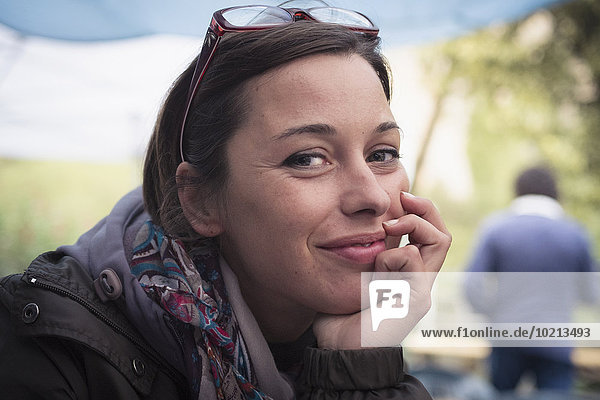 Close up of smiling Caucasian woman