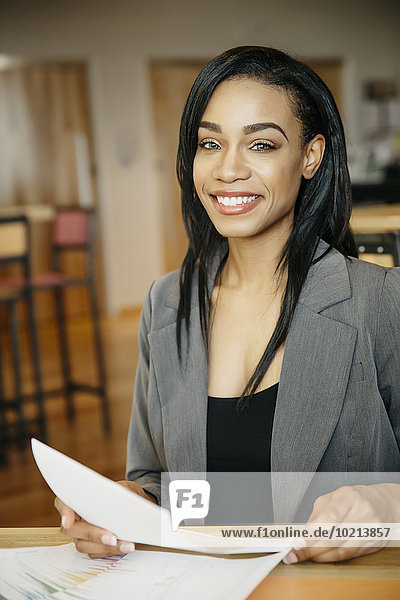 Black businesswoman smiling in cafe