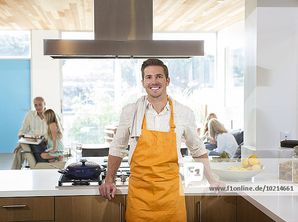 Caucasian man smiling in kitchen