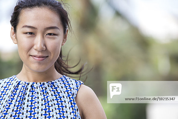Close up of Asian businesswoman smiling outdoors