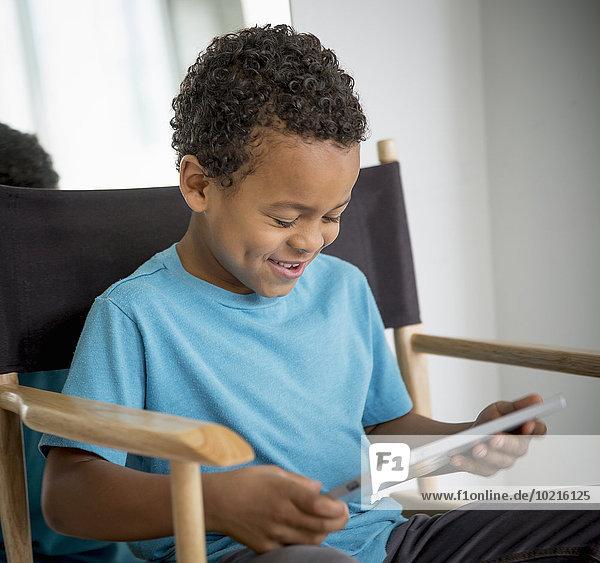 benutzen Stuhl Junge - Person mischen Tablet PC Mixed benutzen,Stuhl,Junge - Person,mischen,Tablet PC,Mixed