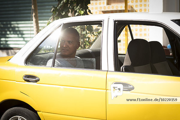 Mexico  Puerto Vallarta  tourist sitting in taxi looking through window