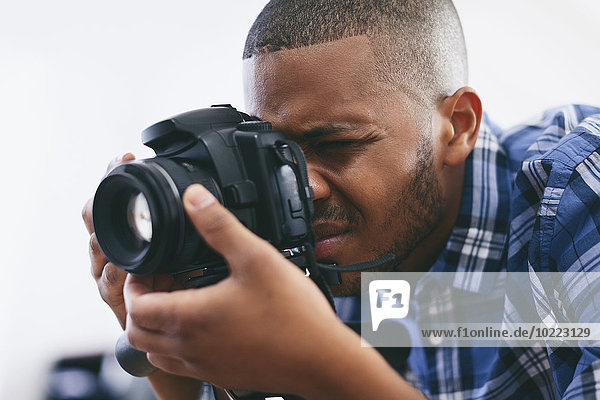 Young man at work in his photographic studio