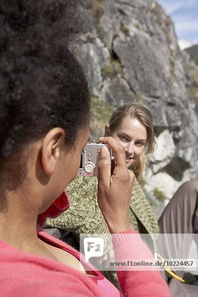 Switzerland  woman taking a photo of her female friend