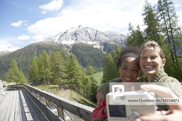 Switzerland  two happy women taking a selfie with camera