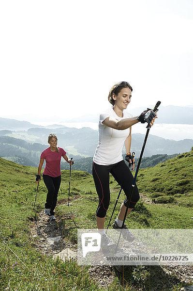 Austria  Two women Nordic walking at Kranzhorn