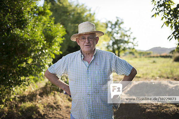 Portrait of farmer with hands on his hips